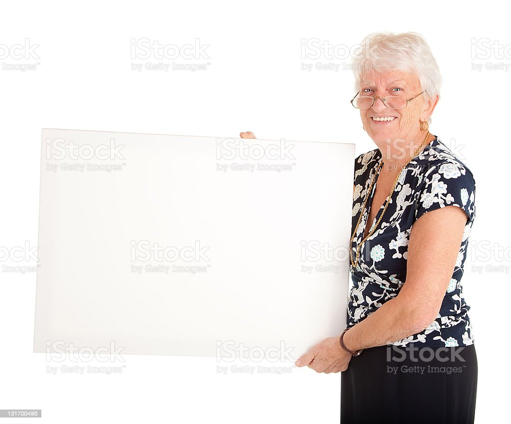 Senior Businesswoman Holding a Blank Sign royalty-free stock photo