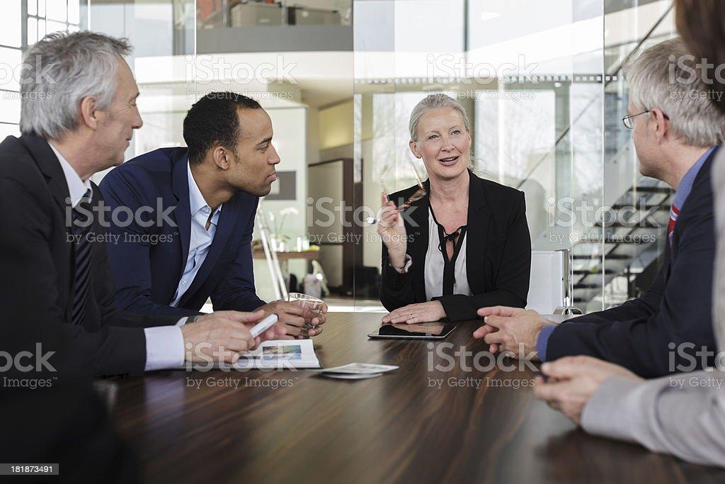 Senior Businesswoman leading a meeting royalty-free stock photo
