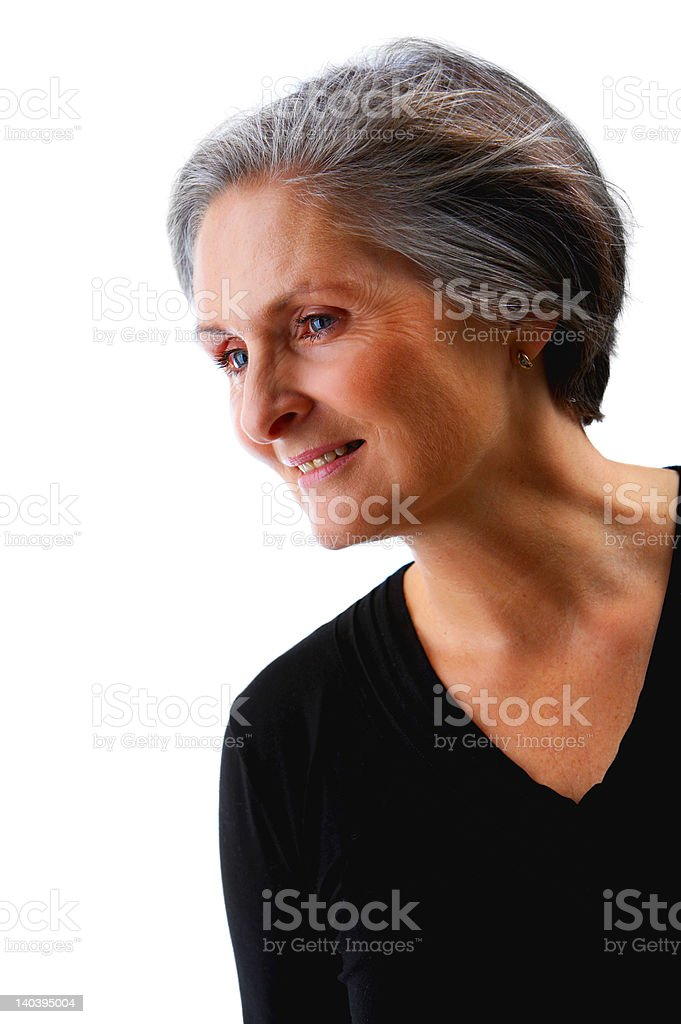 Senior businesswoman looking away in thought royalty-free stock photo