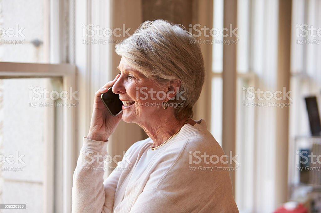 Senior Businesswoman On Mobile Phone In Office stock photo