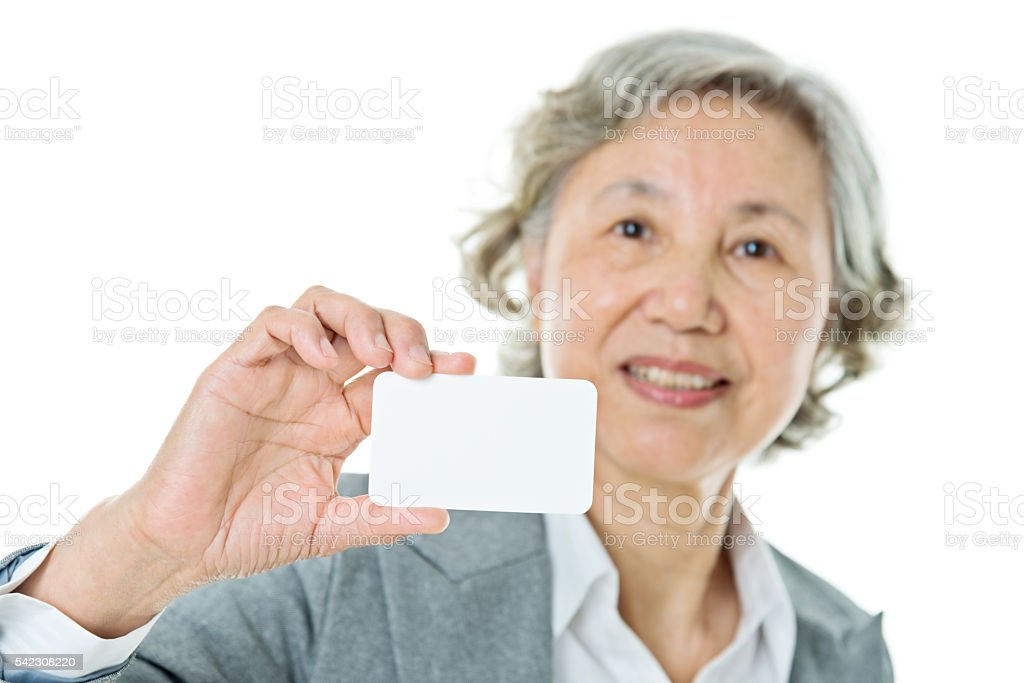 Senior businesswoman with blank business card stock photo