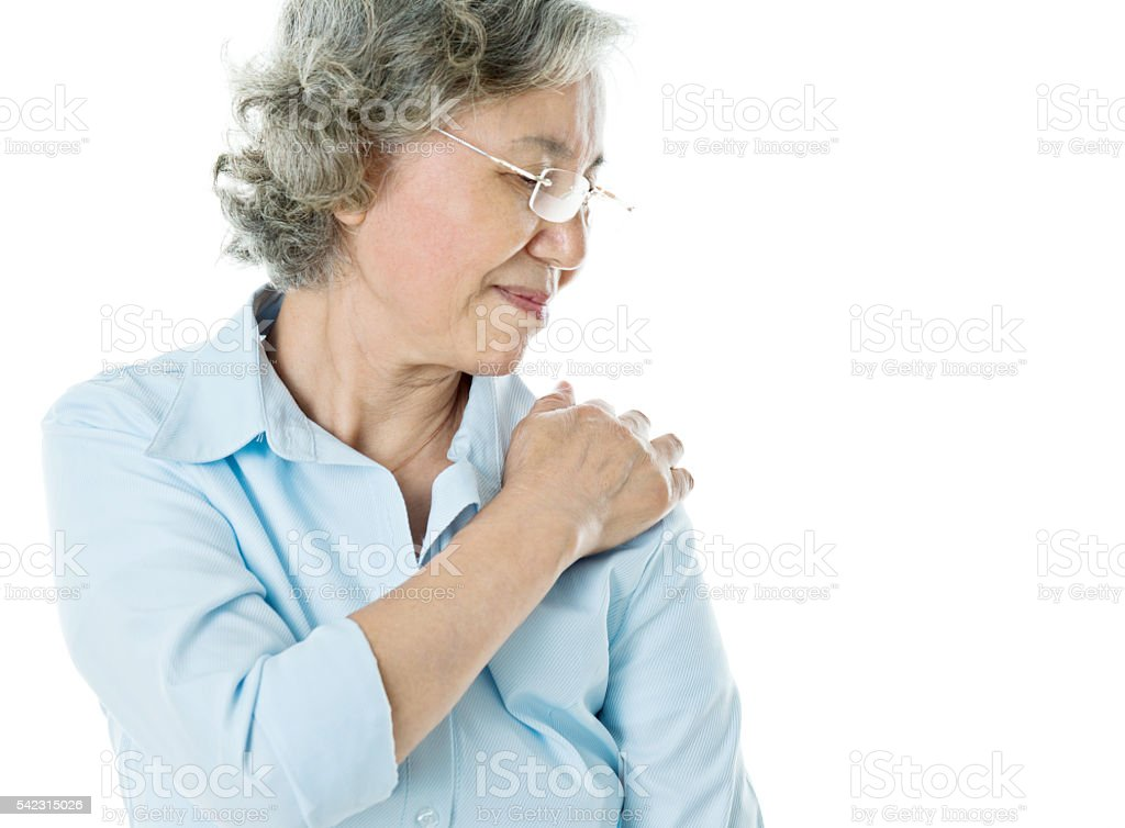 Senior businesswoman with shoulder pain stock photo