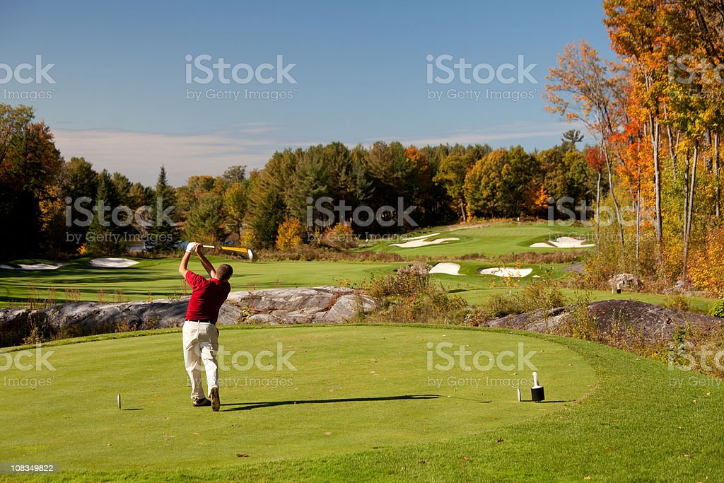 Senior Caucaisan Golfer on the Tee in Fall stock photo