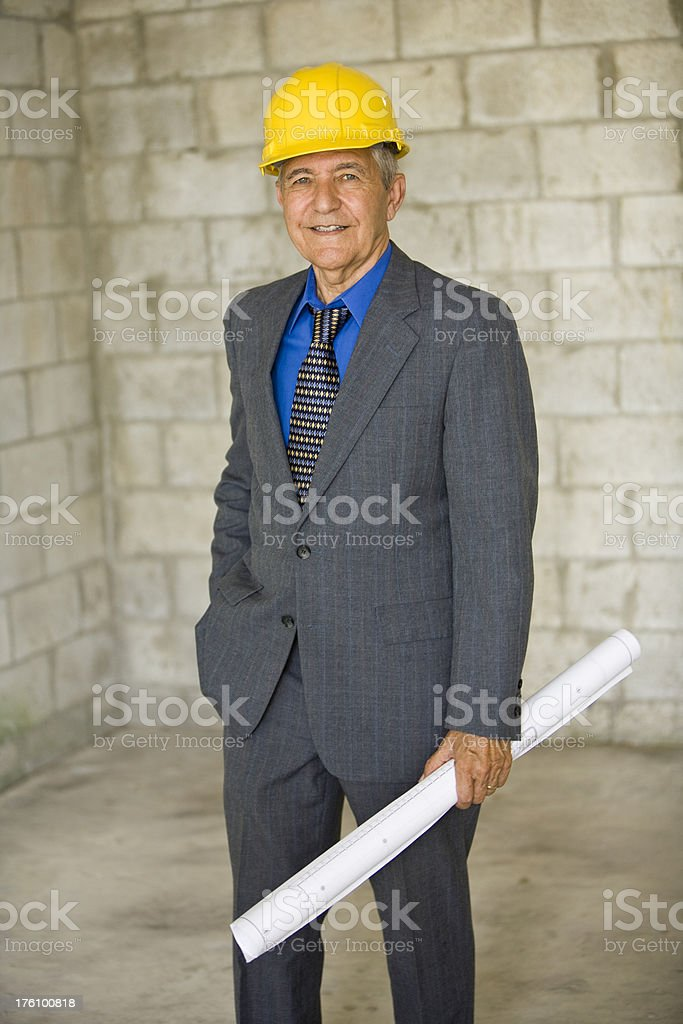 Senior caucasian Architect holding building plans royalty-free stock photo