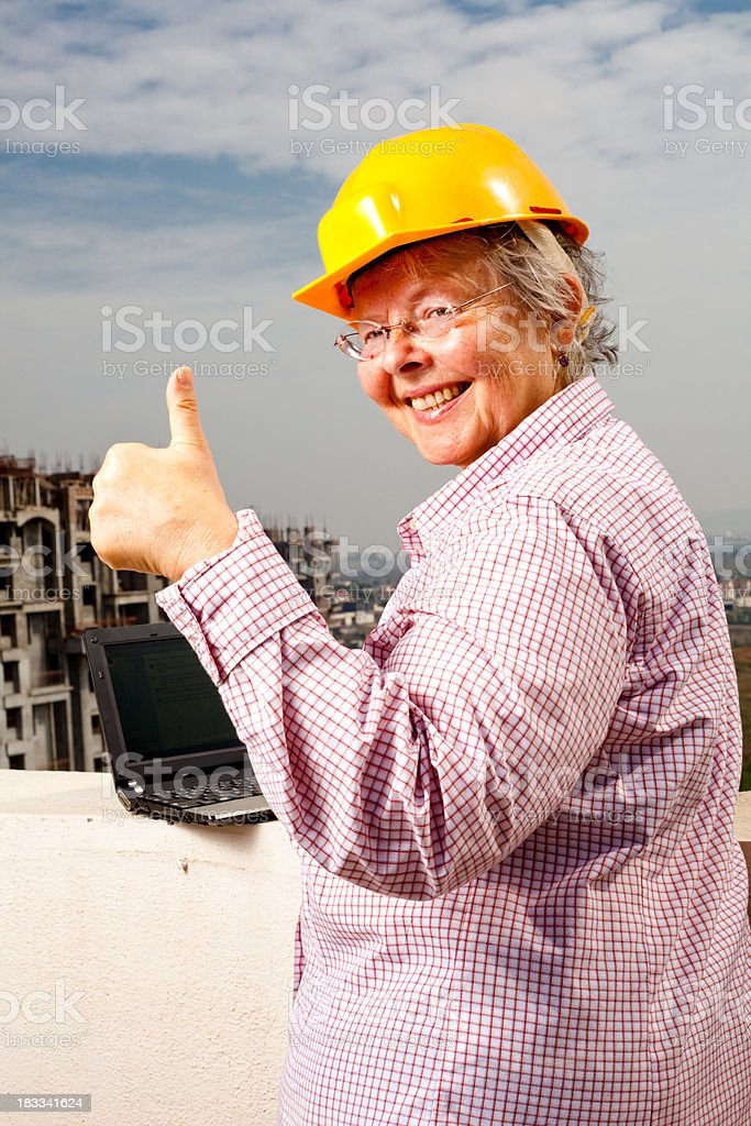 Senior Caucasian Cheerful Woman Engineer Architect with Laptop Construction Site royalty-free stock photo