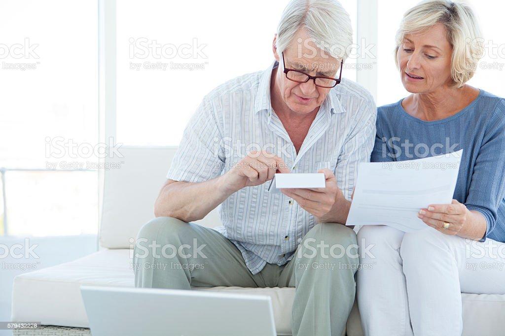 Senior Caucasian couple doing home finances stock photo