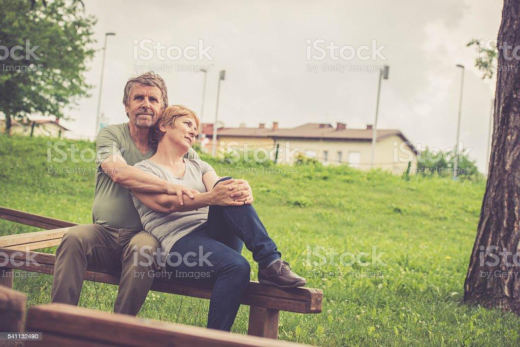 Senior caucasian couple hugging outdoors stock photo