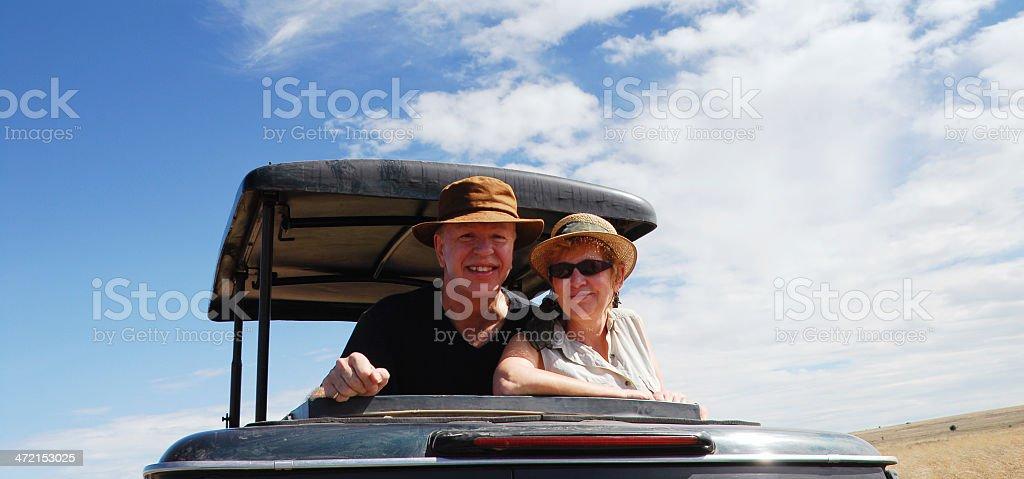 Senior caucasian couple on safari in Serngeti National Park,Tanzania royalty-free stock photo