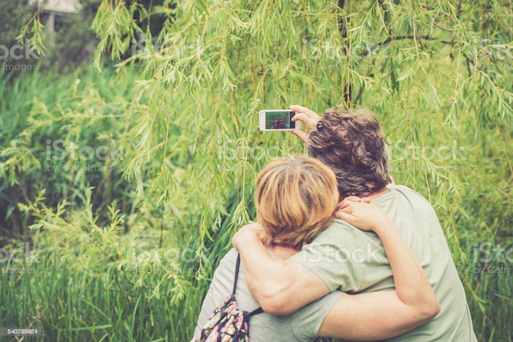 Senior caucasian couple taking selfie - back view stock photo