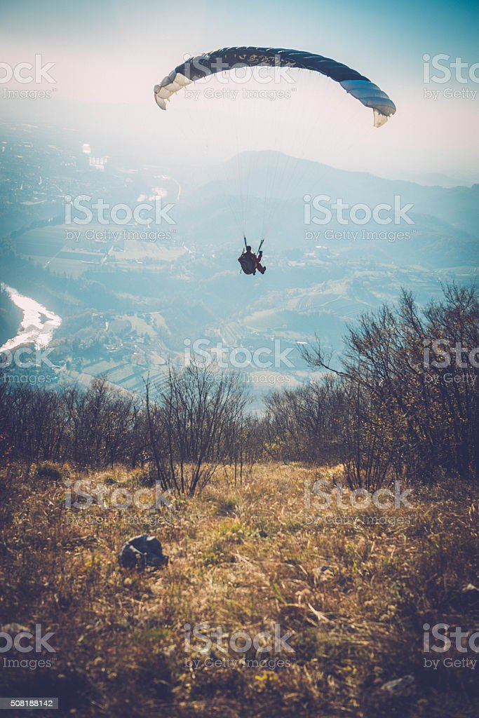 Senior Caucasian Paraglider Starting his Flight, Winter, Alps, Europe stock photo