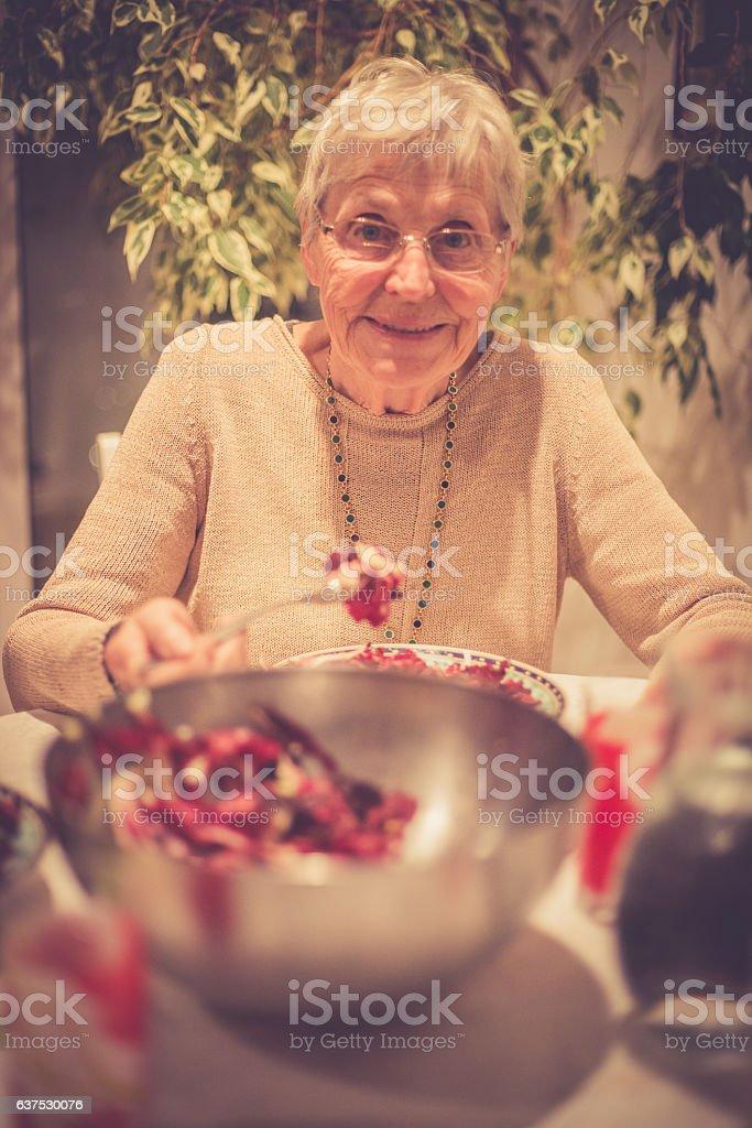 Senior Caucasian Woman Eating Radicchio for Dinner, Brac, Croatia stock photo