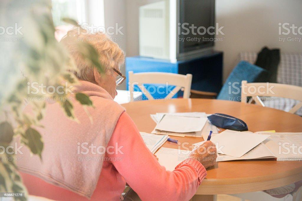 Senior Caucasian Woman Studying at Home, Brac, Croatia stock photo