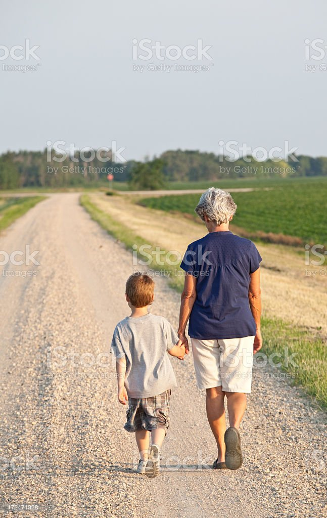 Grandmother Walking with Grandson royalty-free stock photo