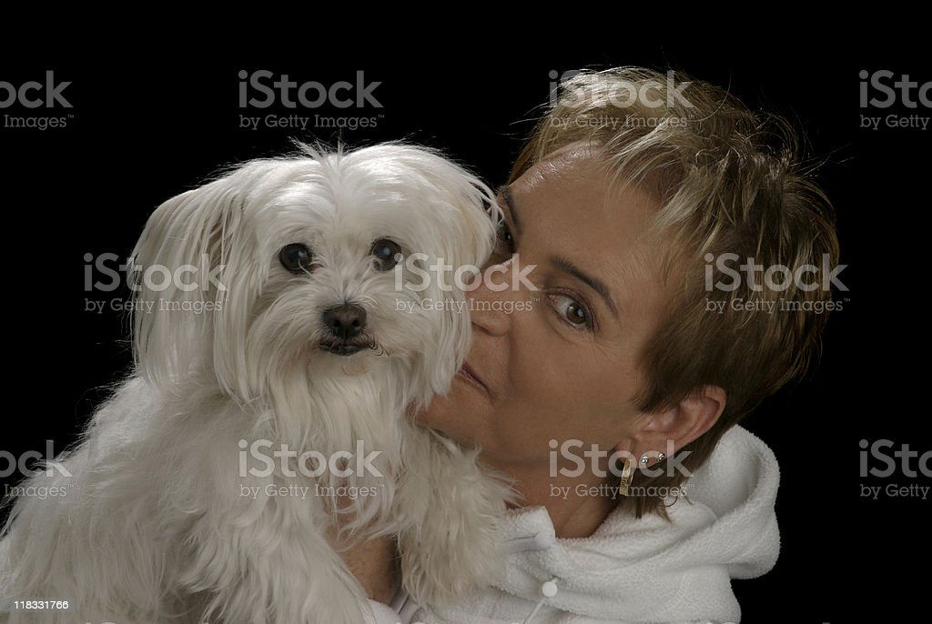 Senior Caucasian woman with her puppy royalty-free stock photo