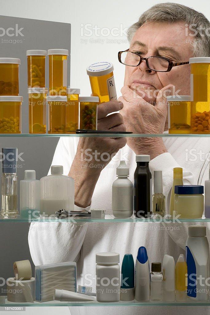 Senior checking his medications royalty-free stock photo