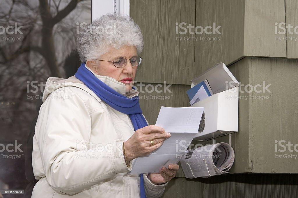 Senior Checking the Mailbox stock photo
