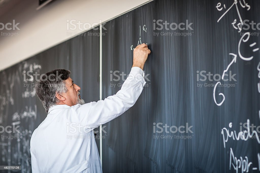 Senior chemistry professor giving a lecture stock photo