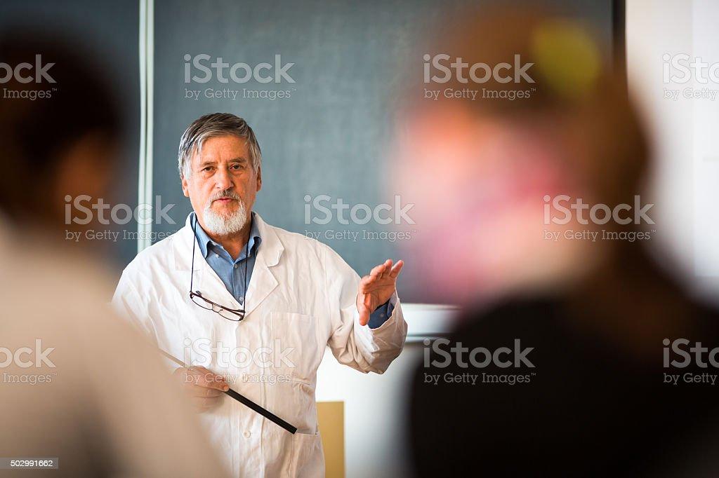 Senior chemistry professor giving a lecture stock photo