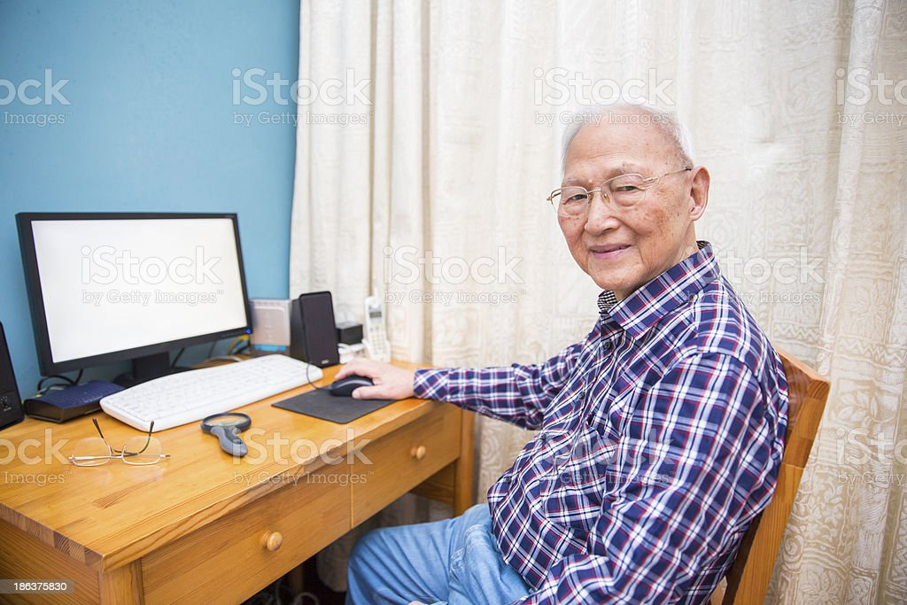 Senior Chinese Man Using a Computer royalty-free stock photo