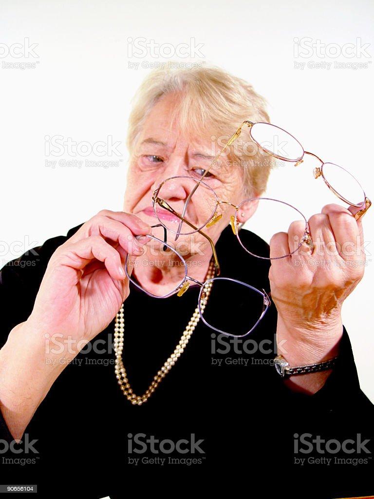 senior - choosing glasses royalty-free stock photo