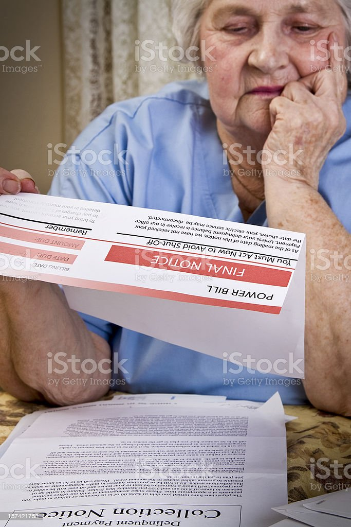 Senior Citizen and Finances, Senior Viewing Power Bill Final Notice. royalty-free stock photo
