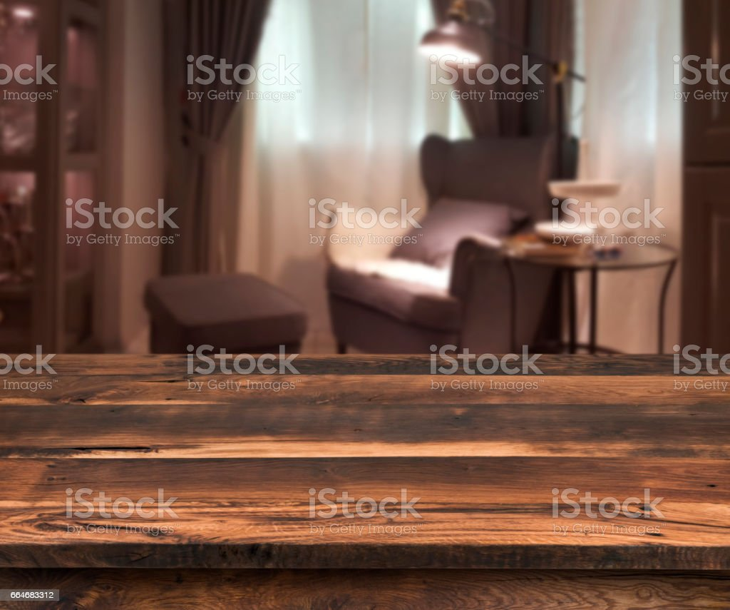 Senior citizen blur living room interior, wooden table in front stock photo