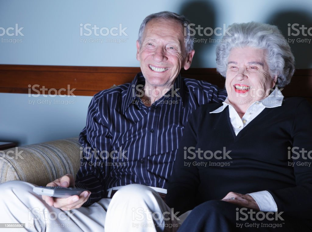 Senior Citizen Couple Watching Television royalty-free stock photo
