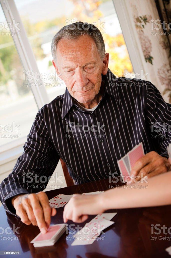 Senior Citizen Man Playing Cards royalty-free stock photo