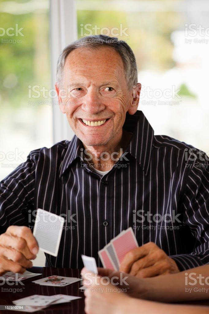 Senior Citizen Man Playing Cards stock photo