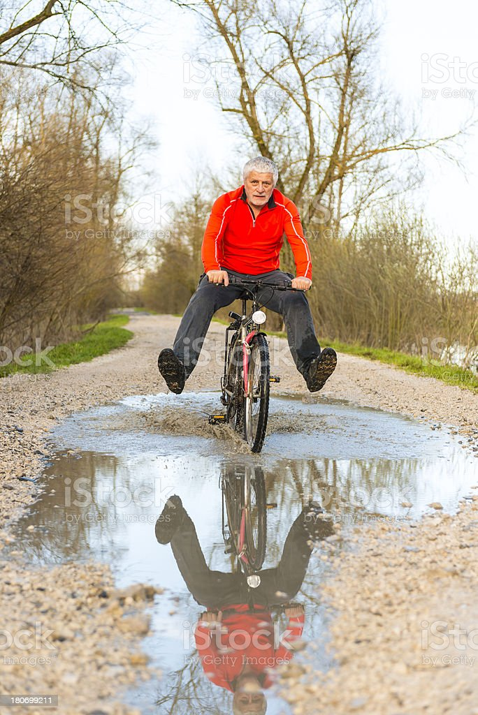 Senior citizen ringing a bicycle royalty-free stock photo