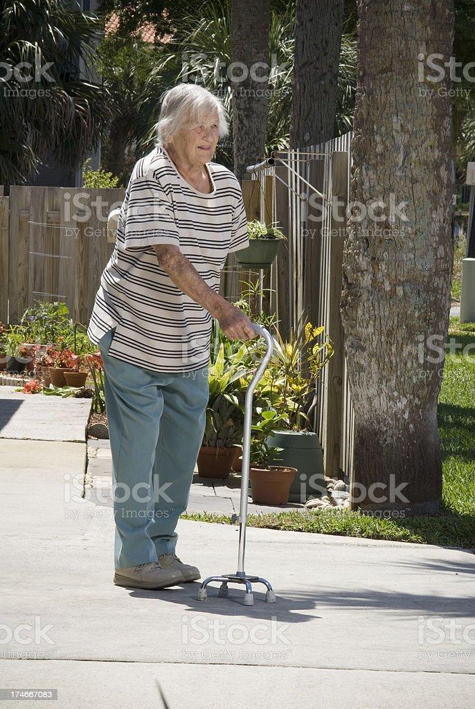Senior citizen with a cane royalty-free stock photo