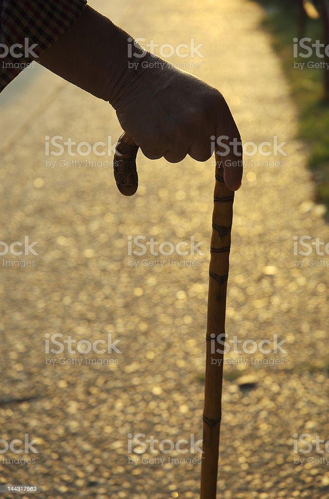 Senior citizen with cane royalty-free stock photo