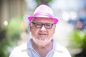 Senior Citizen with pink fedora hat