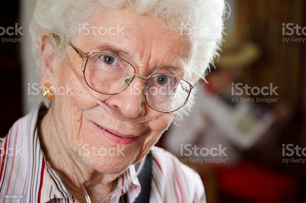 Senior Citizen Woman with Oxygen Tube stock photo