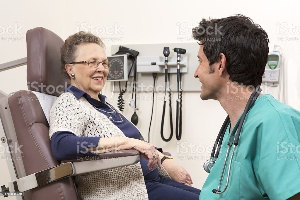 Senior Citizens at a doctor visit royalty-free stock photo