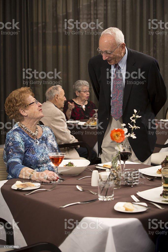 Senior Citizens talking and enjoying dining experience royalty-free stock photo