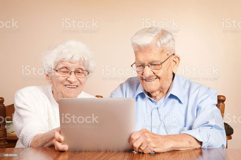 Senior Citizens Using an Electronic Tablet stock photo