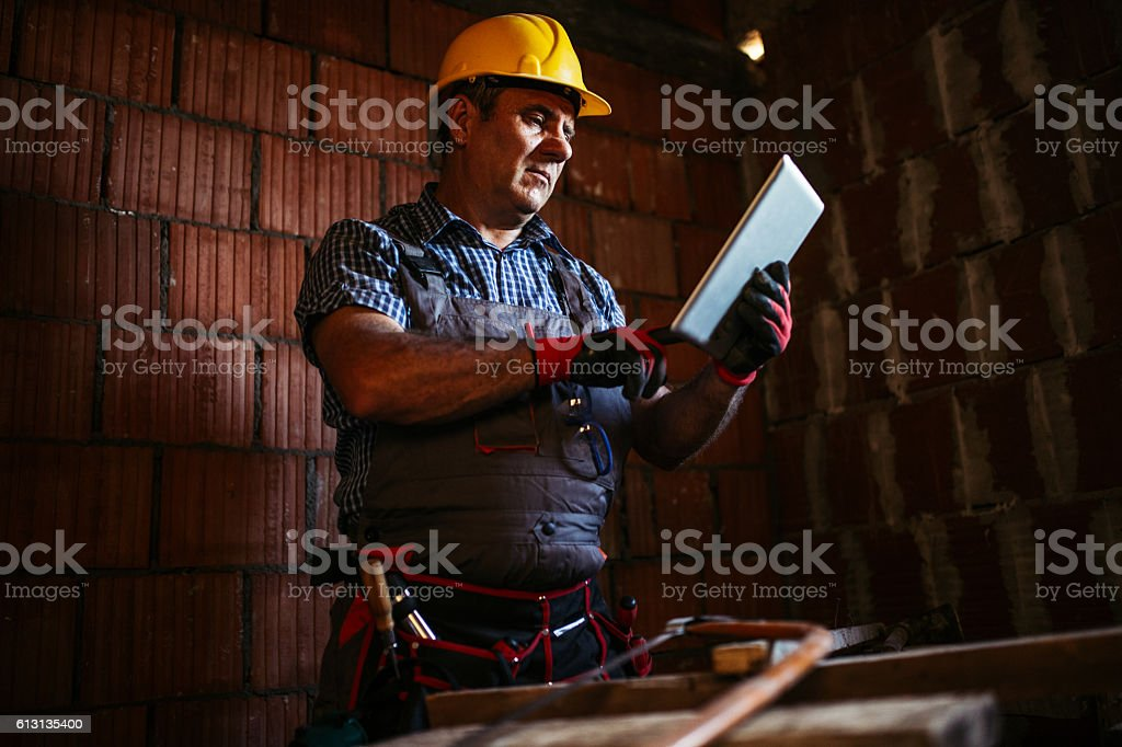 Senior construction worker planning stock photo
