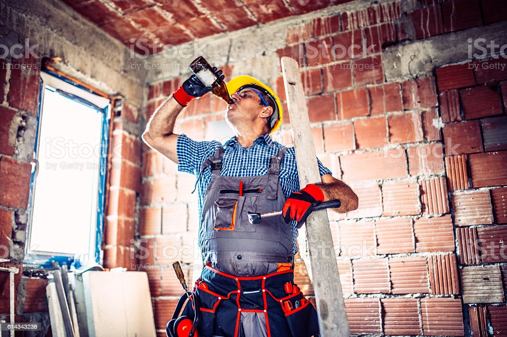 Senior construction worker relaxing stock photo