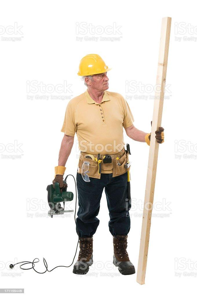 Senior constructor with circular saw royalty-free stock photo