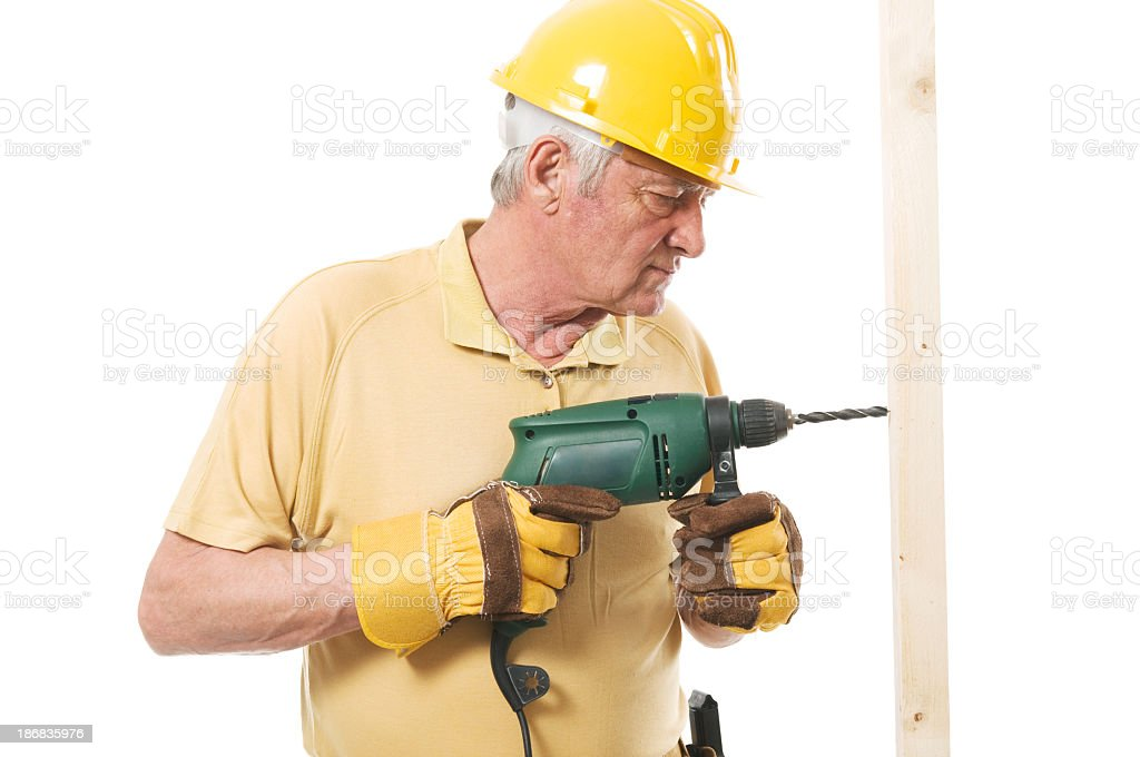 Senior constructor with drill royalty-free stock photo