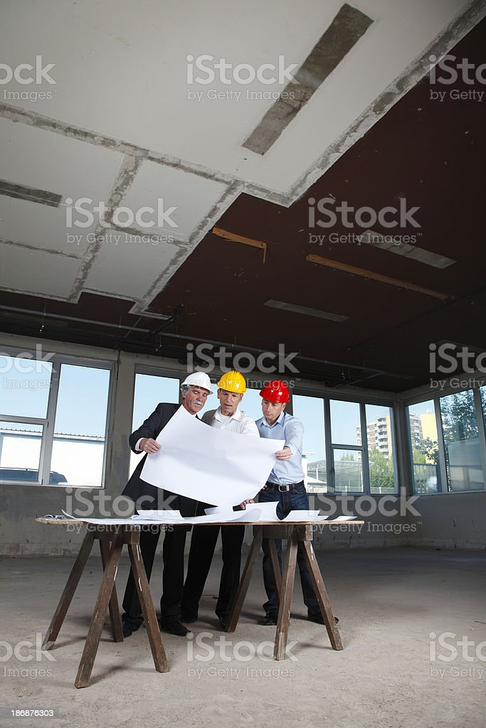 Senior contrators at construction site. royalty-free stock photo