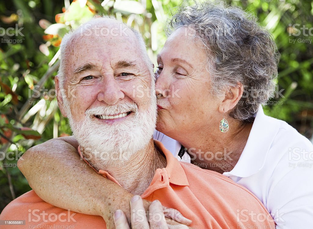Senior Couple - Affectionate Kiss royalty-free stock photo