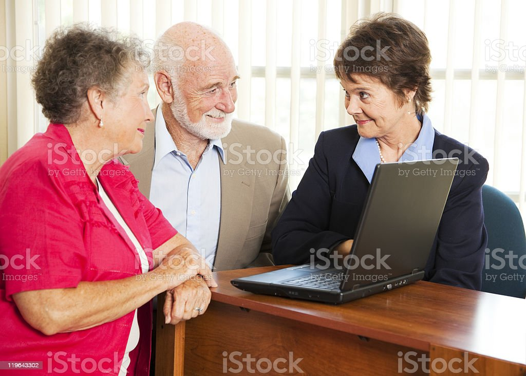 Senior Couple and Financial Consultant royalty-free stock photo