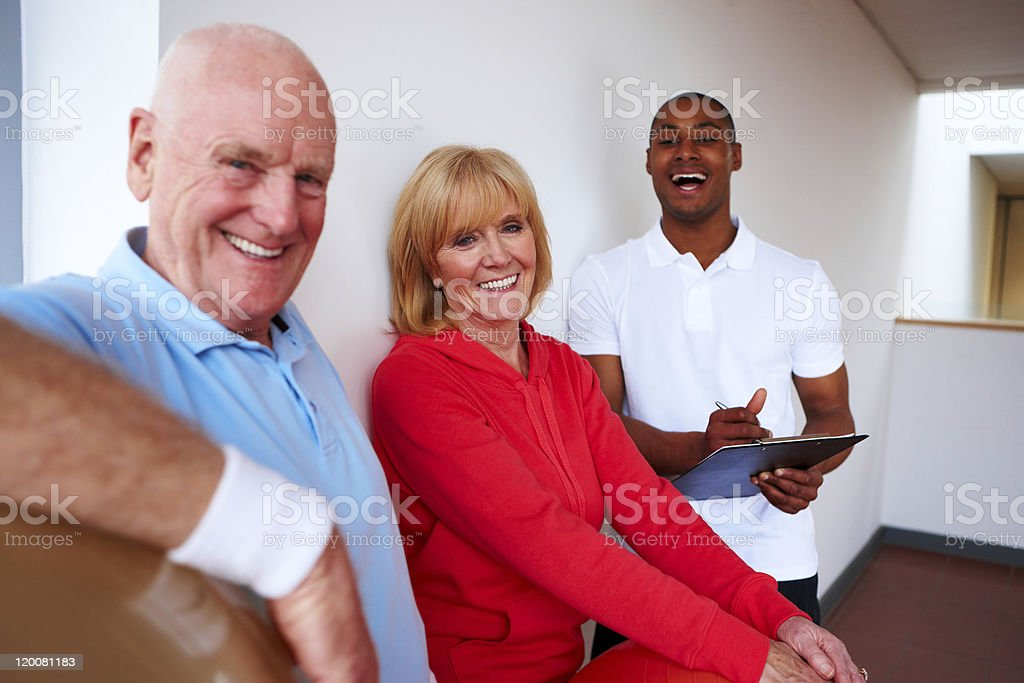 Senior Couple and Personal Trainer royalty-free stock photo