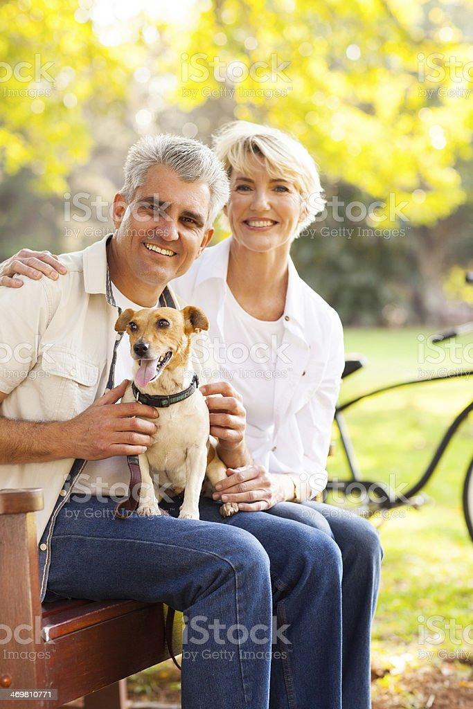 senior couple and pet dog stock photo