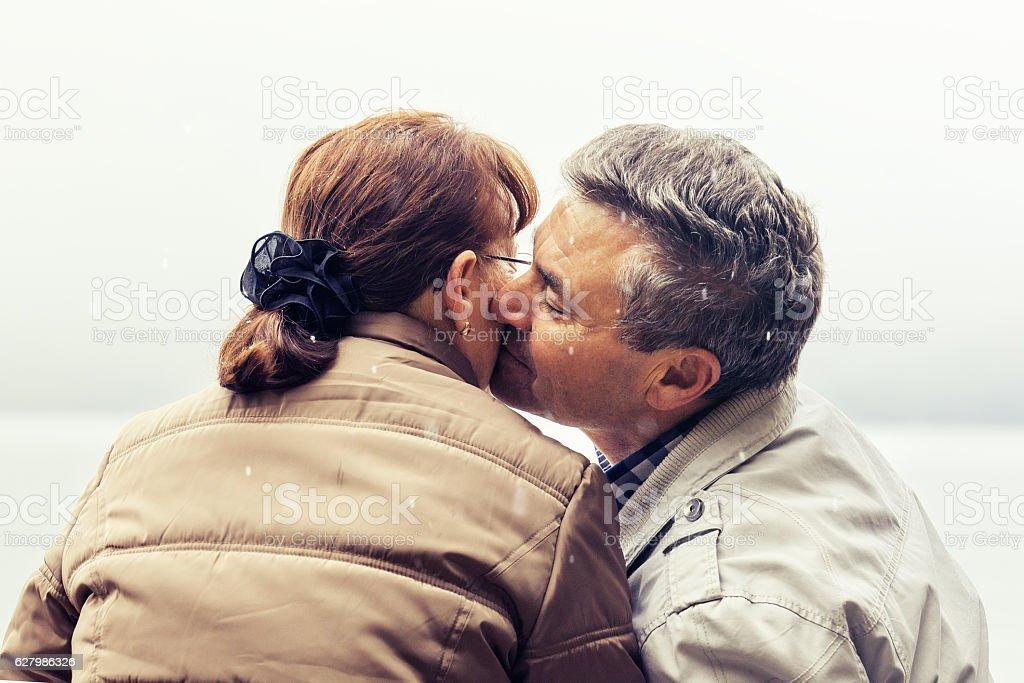 Senior couple and snow stock photo