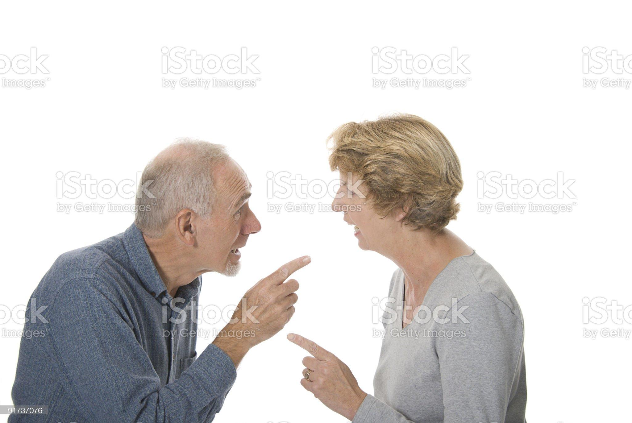Senior couple arguing animatedly. royalty-free stock photo