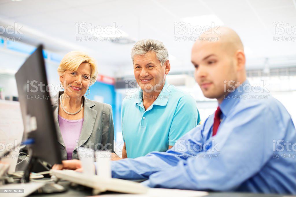 Senior couple at appliance store paying for purchase stock photo