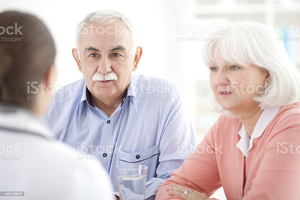 Senior couple at doctor's office royalty-free stock photo